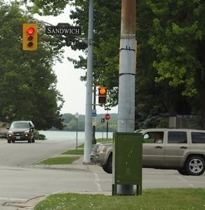 crosswalk sign with pumpkin instead of hand signal