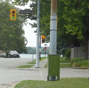 crosswalk sign with pumpkin instead of hand signal with green traffic light